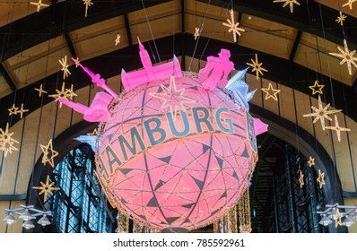 Hamburg, Germany - December 30, 2017: Big Christmas ball hangs in Hamburg Central Station, by Natascha Kaukorat