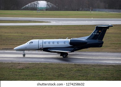 Hamburg, Germany - December 30, 2018:  Embraer Phenom 300  on the Runway of Airport Hamburg in germany - D-CKJE, Luxaviation Germany Embraer Phenom 300