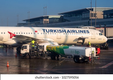 Hamburg, Germany - February 09, 2018: The plane at the airport is fueled. Fuel is supplied from a tank truck.