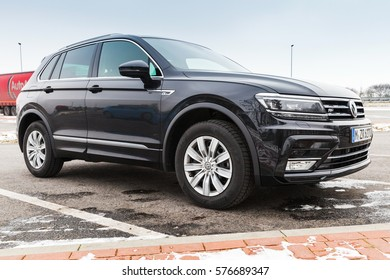 Hamburg, Germany - February 10, 2017: Outdoor photo of second generation Volkswagen Tiguan, 4x4 R-Line. Black compact crossover vehicle CUV by German automaker Volkswagen, side view