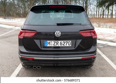 Hamburg, Germany - February 10, 2017: Outdoor photo of second generation Volkswagen Tiguan, 4x4 R-Line. Black compact crossover vehicle CUV manufactured by German automaker Volkswagen, rear view