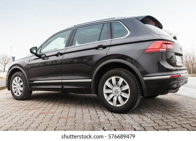 Hamburg, Germany - February 10, 2017: Outdoor photo of second generation Volkswagen Tiguan, 4x4 R-Line. Black compact crossover vehicle CUV manufactured by German automaker Volkswagen, back side