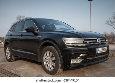 Hamburg, Germany - February 10, 2017: Outdoor photo of second generation Volkswagen Tiguan, R-Line. Black compact crossover vehicle CUV stands on the parking lot