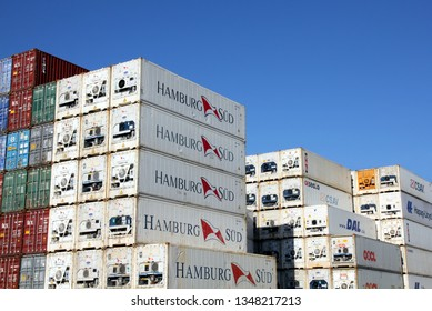 HAMBURG, GERMANY - FEBRUARY 24, 2019: Plenty of refrigerated shipping containers of Hamburg Süd, DAL, CSAV, OOCL and HAPAG-LLOYD container shipping company stacked at the Port of Hamburg