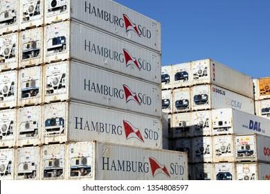 HAMBURG, GERMANY - FEBRUARY 24, 2019: Plenty of refrigerated shipping containers of Hamburg Süd, DAL, CSAV, OOCL and TAL stacked at the Port of Hamburg