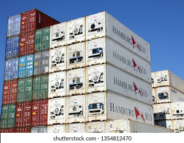 HAMBURG, GERMANY - FEBRUARY 24, 2019: Plenty of refrigerated shipping containers of Hamburg Süd container shipping company stacked at the Port of Hamburg the refrigeration units being visible