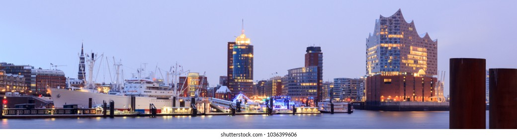 Hamburg, Germany - February 27, 2018: Elbe Philharmonic Hall (Elbphilharmonie) and River Elbe panorama in winter at morning with snow. The Elbphilharmonie is a concert hall in the HafenCity quarter.
