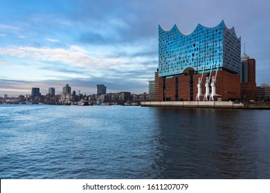 "Hamburg Germany Harbour Panorama with St. Pauli Landungsbrücken and famous Concert Hall ""Elbphilharmonie"" and cranes seen from a harbour cruise ferry boat is a main attraction in the ""Hansestadt"""