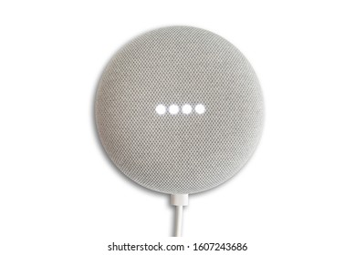 Hamburg, Germany January 06 2020: top view of Google Home Mini smart speaker while activated isolated on white background