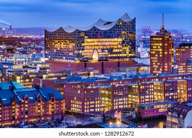 Hamburg, Germany - January 11, 2019: Aerial view of the concert hall Elbphilharmonie and the surrounding harbor and Harbor District at dusk.