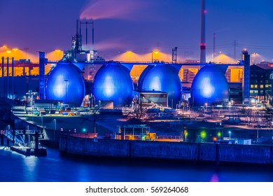 Hamburg, Germany - January 28, 2017: The harbor at dusk. View of the digestion towers of the Hamburg Waterworks wastewater treatment plant.