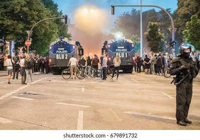 Hamburg, Germany - July 07, 2017: Shot of police and demonstrators during G20 summit in Hamburg 2017