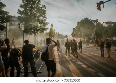 Hamburg, Germany - July 07, 2017: Smokey demonstrators during G20 summit in Hamburg 2017