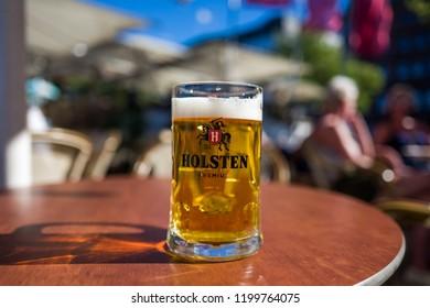 Hamburg, Germany - July 14, 2018: A glass of Holsten Premium beer in Hamburg.