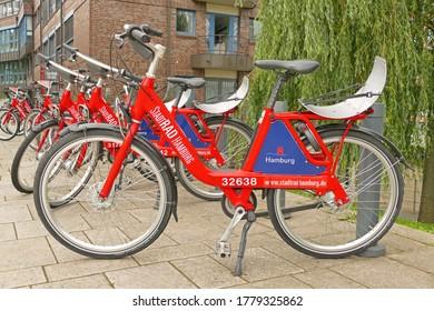 "HAMBURG, GERMANY - July 16, 2020: Rental bikes of ""Stadtrad Hamburg"" waiting for guests in Hafencity"