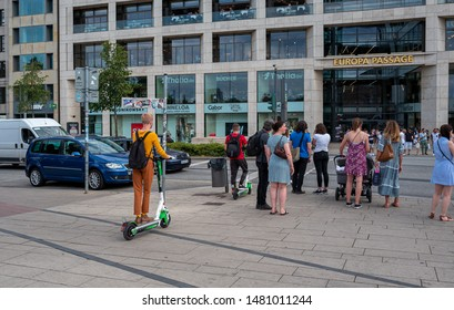 Hamburg; germany, july, 20, 2019, mobile e scooter en route with tourists in the inner city of hamburg