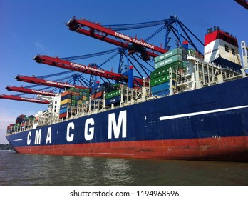 Hamburg, Germany - July, 2015: Cargo ship from CMA CGM Group, a french shipping and logistics company. Ship deck stacked with containers (from UASC, China Shipping). Loading docks Terminal Burchardkai