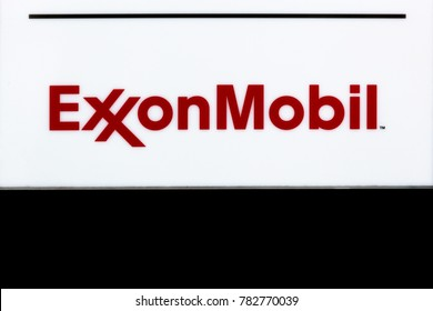 Hamburg, Germany - July 21, 2017: Exxon Mobil logo on a wall. Exxon Mobil Corporation is an American multinational oil and gas corporation headquartered in Irving, Texas