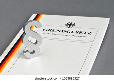 Hamburg / Germany - July 30, 2015: Paragraph sign and The Basic Law for the Federal Republic of Germany - Grundgesetz - is the constitution of the Federal Republic of Germany