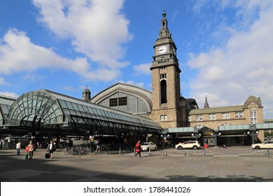 Hamburg, Germany - July 4, 2019: People and taxi cabs in front of the central railway station of Hamburg, Germany on July 4, 2019