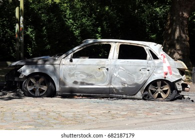 HAMBURG, GERMANY - JULY 9, 2017: Torched car in the wake of the riots during the G20 summit at Max-Brauer-Allee