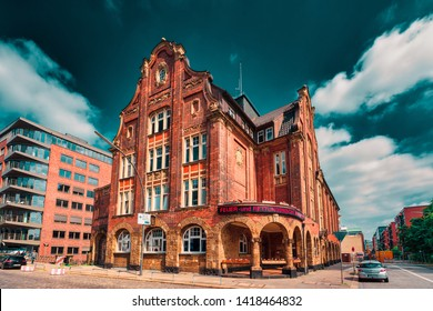 HAMBURG, GERMANY - June 01, 2019: The famous firehouse at Herrengrabenfleet is glooming with its red bricks in the warm sun