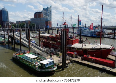 HAMBURG, GERMANY - JUNE 18, 2015: Landungsbruecken of St. Pauli are a very attractive spot for tourists and visitors who enjoy sightseeing in combination with maritime atmosphere
