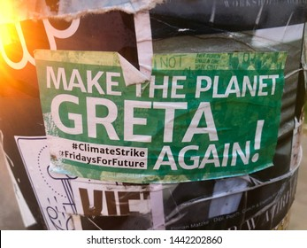"""Hamburg, Germany - June 21, 2019: A sticker posted to a street sign in Hamburg is reading """"Make the planet Greta Again"""", promoting the global Fridays For Future strike for the planet by students"""