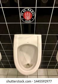 Hamburg, Germany - June 21, 2019: Logo of the German soccer club FC St. Pauli above the urinal in stadium a restroom in Hamburg, Germany