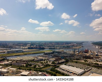 Hamburg, Germany - June 22, 2019: Arial view on Hamburg port with an Aida cruise ship and the Cosco Shipping Leo container ship waiting to leave Hamburg for their future destinations.