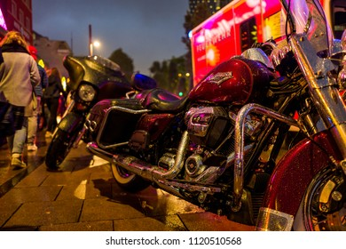 Hamburg, Germany - June 23, 2018: A Harley Davidson in the rain in front of Emergency car at the Reeperbahn.
