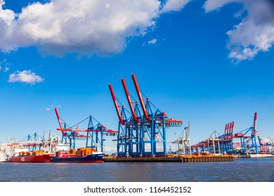 HAMBURG, GERMANY - JUNE 25, 2014: Docks of Port of Hamburg (Hamburger Hafen, Terminal Burchardkai) on Elbe river, Germany. The largest port in Germany and one of the busiest ports in Europe