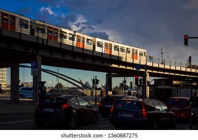 Hamburg, Germany - June 25, 2014: U-Bahn train moves on the Binnenhafenbrucke bridge in Hamburg city. Hamburg U-Bahn is a rapid transit system serving the cities of Hamburg, Norderstedt and Ahrensburg
