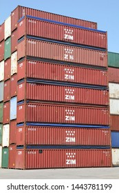 HAMBURG, GERMANY - JUNE 30, 2019: Stacked open top shipping containers of ZIM Integrated Shipping Services Ltd. - the biggest cargo shipping company in Israel - at the Port of Hamburg