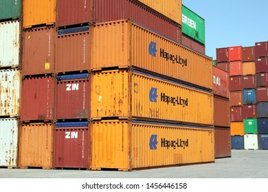HAMBURG, GERMANY - JUNE 30, 2019: Stacked shipping containers of HAPAG-LLOYD and ZIM at the Port of Hamburg