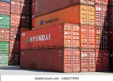 HAMBURG, GERMANY - JUNE 30, 2019: Stacked shipping containers of HAPAG-LLOYD and HYUNDAI at the Port of Hamburg