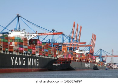 HAMBURG, GERMANY - JUNE 30, 2019: The Container ship YM WITNESS of the Taiwanese shipping company YANG MING and HONG KONG EXPRESS of HAPAG-LLOYD at the maritime container port Terminal ALTENWERDER