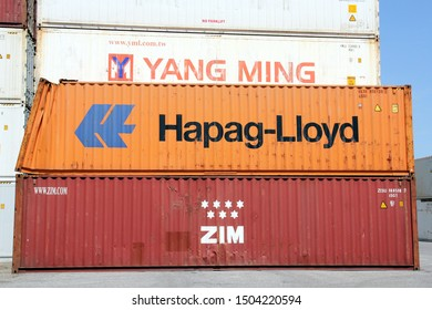 HAMBURG, GERMANY - JUNE 30, 2019: Shipping containers stacked at the Port of Hamburg, the Hapag-Lloyd container among them being damaged