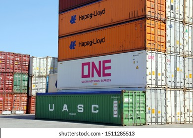 HAMBURG, GERMANY - JUNE 30, 2019: Stacked variegated shipping containers of HAPAG-LLOYD, ONE (OCEAN NETWORK EXPRESS) and UASC at the Port of Hamburg