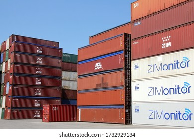 HAMBURG, GERMANY - JUNE 30, 2019: ZIMONITOR temperature controlled shipping containers of ZIM and general purpose standard containers as well as open top conatiners at the Port of Hamburg