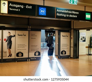 HAMBURG, GERMANY - MAR 20, 2018: Businessman exiting airport terminal through nothing to declare gate