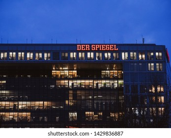 Hamburg, Germany - Mar 21, 2018: Headruqrter of Der Spiegel The Mirror newspaper weekly news magazine on Ericusspitze street at dusk - journalism working late and neon sign