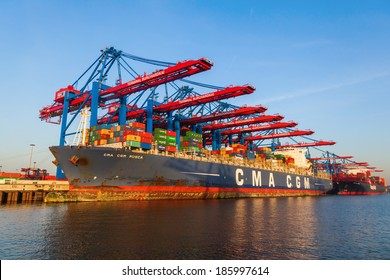 HAMBURG, GERMANY - MARCH 10: CMA CGM Musca container ship on March 10, 2014 in Hamburg. CMA CGM is a French container transportation company. It is the third largest container company in the world.