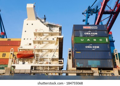 HAMBURG, GERMANY - MARCH 10: container shipment in the port of Hamburg on March 10, 2014 in Hamburg. The port of Hamburg is the largest seaport in Germany and the second largest of Europe.
