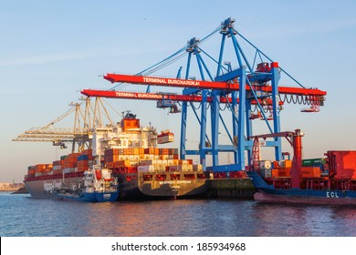 HAMBURG, GERMANY - MARCH 10: container ship from Hapag-Lloyd shipping company in the Burchardkai on March 10, 2014. Burchardkai is the largest container terminal of the Hamurg port.
