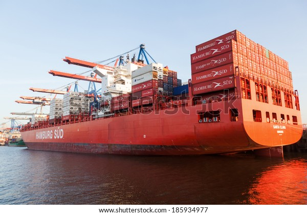 HAMBURG, GERMANY - MARCH 10: container ship Santa Clara of the Hamburg Sued shipping company in the Burchardkai on March 10, 2014. Burchardkai is the largest container terminal of the Hamurg port.