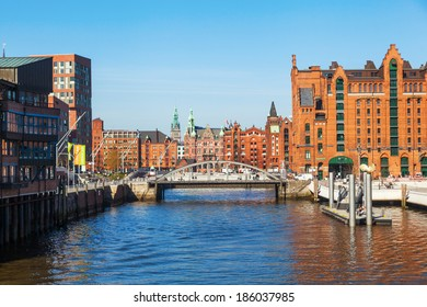 HAMBURG, GERMANY - MARCH 10: view on the HafenCity with a bridge and part of the famous Speicherstadt on March 10, 2014 in Hamburg. The HafenCity is the largest city rebuilding project in Europe.