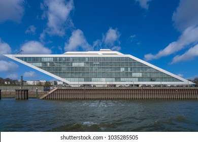 Hamburg, Germany - March 15, 2017: The Dockland building, an office building with a staircase accessible for visitors and a view over the harbor and the northern bank of the river Elbe.