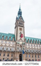 HAMBURG, GERMANY - MARCH, 2018: Hamburg City Hall buildiing located in the Altstadt quarter in the city center at the Rathausmarkt square in a cold rainy early spring day