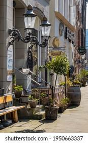 Hamburg, Germany - March 31, 2021: The historic street Deichstraße with Restaurants.